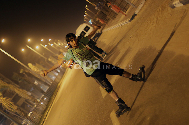 Members of a Palestinian youth skate team show their technique during training in Gaza city on March 8, 2013. Photo by Ezz al-Zanoon