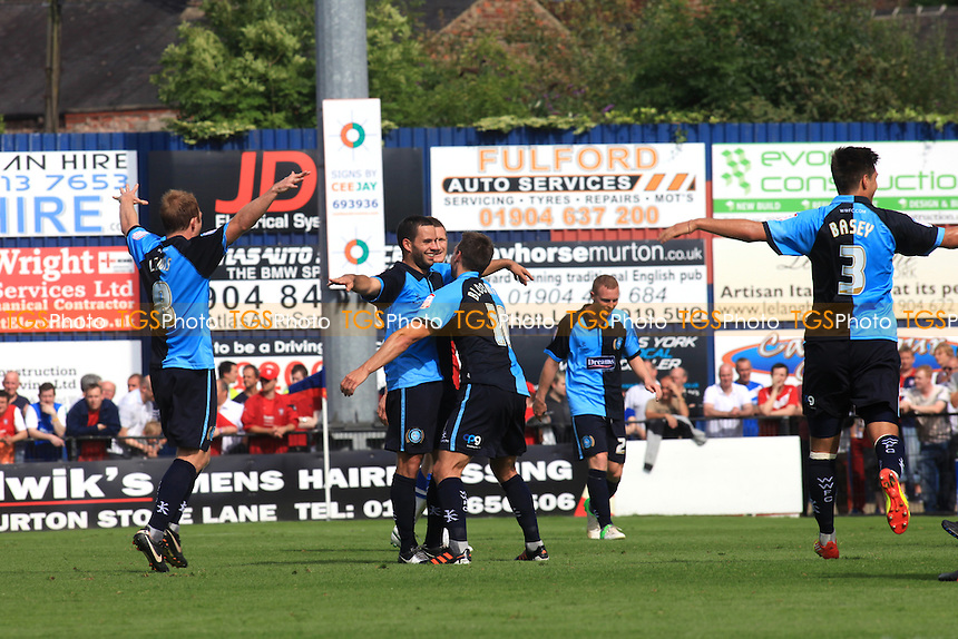 Wycombe players run towards Sam Wood to congratulate him after his first half wondergoal - York City vs Wycombe Wanderers - NPower League Two Football at Bootham Crescent, York - 18/08/12 - MANDATORY CREDIT: Paul Dennis/TGSPHOTO - Self billing applies where appropriate - 0845 094 6026 - contact@tgsphoto.co.uk - NO UNPAID USE.