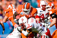 January 1, 2009:      Clemson running back James Davis (1) tries to run over Nebraska safety Rickey Thenarse (3) during the  64th annual Konica Minolta Gator Bowl between the Nebraska Cornhuskers  and the Clemson Tigers  at Jacksonville Municipal Stadium in Jacksonville, Florida. Nebraska defeated Clemson 26-21.