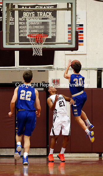 Torrington, CT- 11 January 2016-011116CM08-Torrington's David White attempts to draw the offensive foul as Newtown's Tom Cotton goes to the hoop during their non-conference matchup in Torrington on Monday.   Watching the play is Newtown's Zink Nevin.  Christopher Massa Republican-American