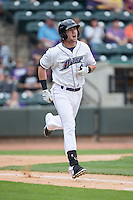 Trey Michalczewski (8) of the Winston-Salem Dash hustles down the first base line against the Myrtle Beach Pelicans at BB&T Ballpark on May 10, 2015 in Winston-Salem, North Carolina.  The Pelicans defeated the Dash 4-3.  (Brian Westerholt/Four Seam Images)