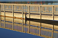 At Pete's Lake in the Hiawatha National Forest, they have built a fishing pier near the campground.  The pier creates some interesting patterns in early morning light.  Schoolcraft County, Michigan