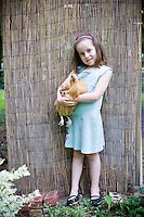 Cleo (daughter of Cynthia Deis) and Fi Fi  together in Cynthia Deis' backyard in downtown Raleigh's Glenwood Brooklyn neighborhood.