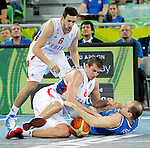 """Vasilije Micic and Nemanja Bjelica of Serbia fights for the ball with Italy`s Marco Cusin during European basketball championship """"Eurobasket 2013""""  basketball game for 7th place between Serbia and Italy in Stozice Arena in Ljubljana, Slovenia, on September 21. 2013. (credit: Pedja Milosavljevic  / thepedja@gmail.com / +381641260959)"""