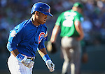 Chicago Cubs' Addison Russell runs up the first base line in a spring training game against the Diamondbacks in Mesa, Ariz., on Thursday, March 17, 2016. The Cubs won 15-4.<br /> Photo by Cathleen Allison