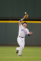 Round Rock Express outfielder Jim Adduci (24) makes a catch during the Pacific Coast League baseball game against the New Orleans Zephyrs on June 30, 2013 at the Dell Diamond in Round Rock, Texas. Round Rock defeated New Orleans 5-1. (Andrew Woolley/Four Seam Images)