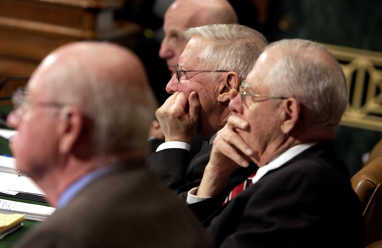 Federal judges John Keenan, left, Allan Kornblum, top, Harold Baker, center, and Stanley Brotman, right, listen to questioning from Senators, during a Senate Judiciary Committee hearing on executive power and the FISA (Foreign Intelligence Surveillance Act) Court.