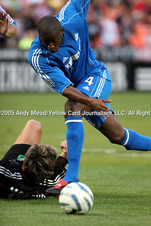 21 May 2005: Shavar Thomas (4) gets the ball away from Jaime Moreno (below). DC United defeated the Kansas City Wizards 3-2 at RFK Stadium in Washington, DC in a regular season Major League Soccer game. . .