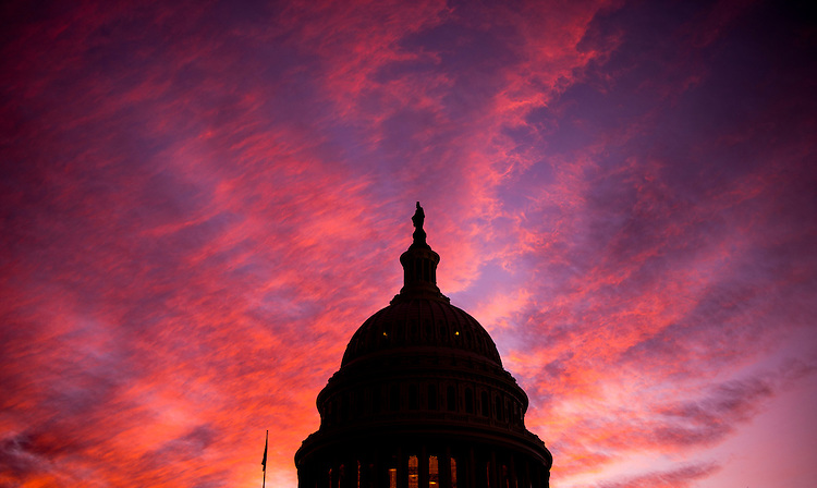 UNITED STATES - DECEMBER 8: The sun sets at the U.S. Capitol as the 114th session of Congress comes to a close on Thursday, Dec. 8, 2016. The House passed spending bill to fund the government through April before heading home for the holiday recess. (Photo By Bill Clark/CQ Roll Call)