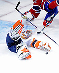 26 October 2009: New York Islanders' goaltender Martin Biron makes a first period save on Montreal Canadiens' left wing forward Travis Moen at the Bell Centre in Montreal, Quebec, Canada. The Canadiens defeated the Islanders 3-2 in sudden death overtime for their 4th consecutive win. Mandatory Credit: Ed Wolfstein Photo