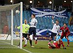 Jordan Rhodes heads in the opener for Scotland