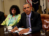 United States President Barack Obama speaks to the press after hosting a roundtable with CEOs to discuss about climate change especially carbon mitigation, sustainability and how new technologies can support these efforts, while Loretta Rosenmayer , CEO InTren, left, listens in the Roosevelt Room of the White House in Washington, DC on October 19, 2015.<br /> Credit: Aude Guerrucci / Pool via CNP
