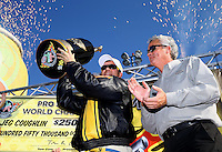 Nov 10, 2013; Pomona, CA, USA; NHRA pro stock driver Jeg Coughlin Jr (left) celebrates alongside NHRA president Tom Compton after clinching the 2013 pro stock championship during the Auto Club Finals at Auto Club Raceway at Pomona. Mandatory Credit: Mark J. Rebilas-