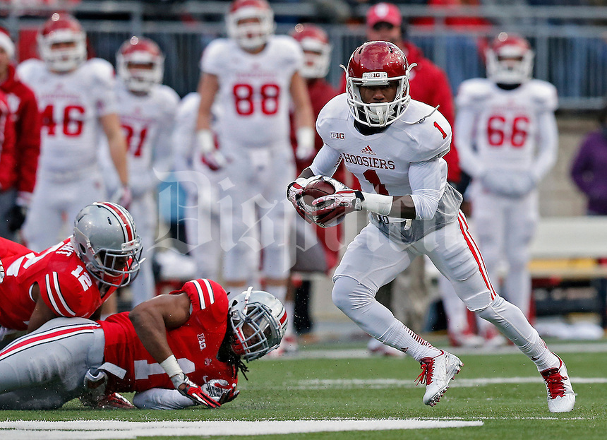 Indiana Hoosiers wide receiver Shane Wynn (1) makes a catch and gets past Ohio State Buckeyes cornerback Bradley Roby (1) during the first quarter of their College football game at Ohio Stadium in Columbus, Ohio on November 23, 2013.  (Dispatch photo by Kyle Robertson)