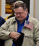 U.S. Army veteran Robert Thomas of Swansea bows his head during the benediction at the end of the ceremony. He served as a Staff Sgt. in the Army, and is now a member of VFW Post #1739 in Belleville. The city of Belleville held their 21st annual Veterans Day ceremony inside Belleville City Hall on Thursday November 11, 2019. It was moved inside due to the winter weather.<br /> Photo by Tim Vizer