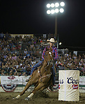 Kelley Schnaufer from Pueblo, CO competes in the Barrel Racing event during Wolf Pack Night at the Reno Rodeo on Wednesday, June 22, 2016.