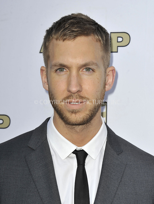 WWW.ACEPIXS.COM....April 17 2013, LA....Calvin Harris arriving at the 30th Annual ASCAP Pop Music Awards at Loews Hollywood Hotel on April 17, 2013 in Hollywood, California......By Line: Peter West/ACE Pictures......ACE Pictures, Inc...tel: 646 769 0430..Email: info@acepixs.com..www.acepixs.com