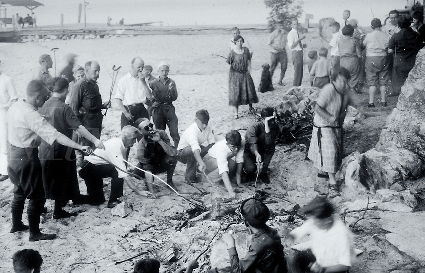 Vintage image of a seaside weenie roast.