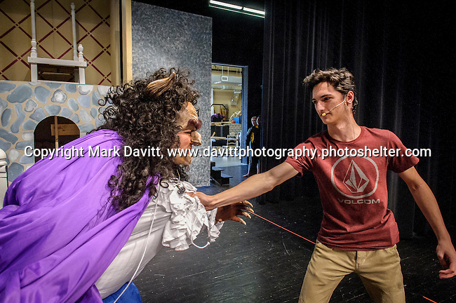 Ozzie Padilla performs as the Beast and Gavin Runles as Gaston rehearse for Southeast Polk High School's Beauty and the Beast to be presented Nov. 11 at 7 p.m. and Nov. 12 at 7 p.m. In addition, on Nov. 12 at 10–11:30 a.m. The players will host a VIP Enchanted Event in which  guests can meet Bell, the Beast, and other characters.