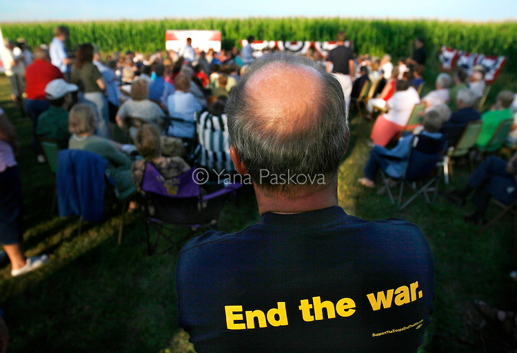 A man's T-shirt protests the war as Democratic Presidential hopeful John Edwards (D-NC) campaigns in Webster City, IA, on July 13, 2007.