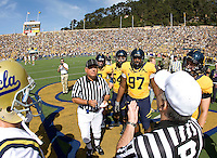 California starting captains, Kevin Riley, Chris Guarnero, Cameron Jordan and Mike Mohamed and UCLA players watch referee tosses a coin before the game against UCLA at Memorial Stadium in Berkeley, California on October 9th, 2010.   California defeated UCLA, 35-7.