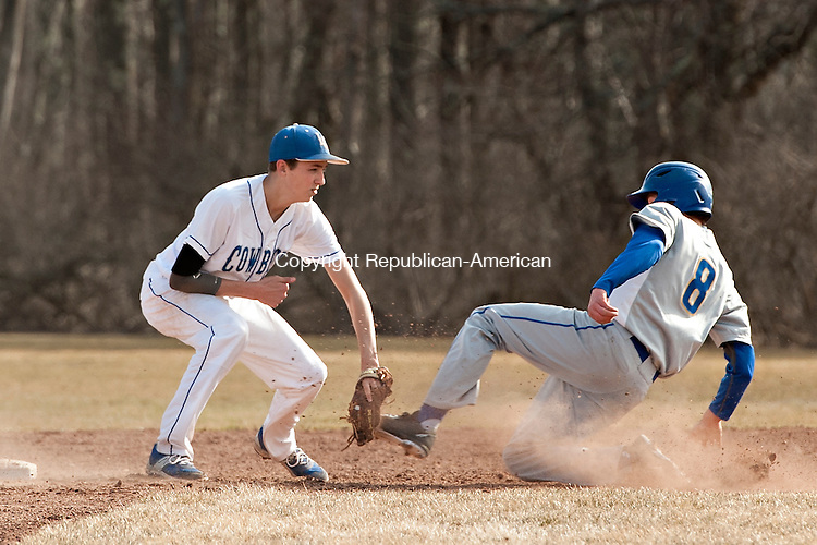 LITCHFIELD, CT-13 April 2015-041315EC06-  Gilbert's Cameron Goulet is out at second base with a tag by Litchfield's Griffon McIntyre in Litchfield Monday. Erin Covey Republican-American