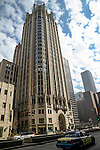 Chicago Tribune building framed by clear blue sky in downtown on Michigan Avenue.