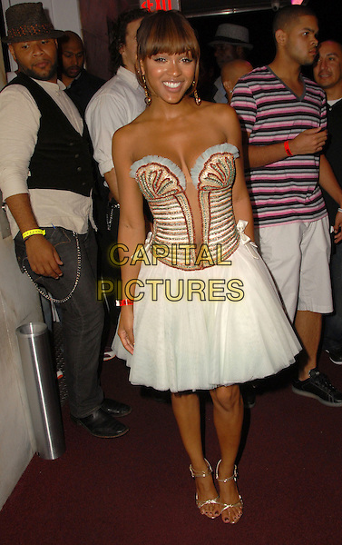MEAGAN GOOD .Meagan Good 27th Birthday Party celebration held at The Standard Hotel, Los Angeles, California, .11 August 2008..full length white  corset top dress strapless blue trim striped low cut tummy button belly skirt  gold strappy shoes sandals .CAP/ADM/FS.©Faye Sadou/Admedia/Capital Pictures