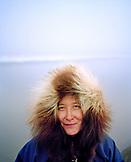 USA, Alaska, Barrow, portrait of a woman wearing a furry hooded jacket in Point Barrow