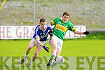 John Mitchels Wayne Duggan and St Mary's Sean O'Shea in action in the Intermediate Club Championship at Austin Stack park, Tralee on Sunday.