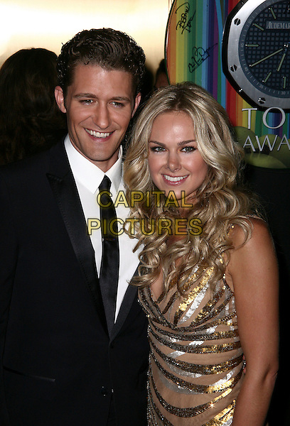 MATTHEW MORRISON & LAURA BELL BUNDY .The 64th Annual TONY AWARDS held at Radio City Music Hall.  The American Theatre Wing's 2010 TONY AWARDS Red Carpet Arrivals, New York, NY, USA, 13th June 2010..arrivals tonys half length black tie suit white shirt gold sequined sequin  .CAP/ADM/PZ.©Paul Zimmerman/AdMedia/Capital Pictures.