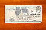 Egyptian 5 pound currency note on table with Arabic script and mosque