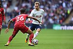 Christian Eriksen of Tottenham Hotspur is challenged by  Kyle Naughton of Swansea City during the premier league match at the Wembley Stadium, London. Picture date 16th September 2017. Picture credit should read: Robin Parker/Sportimage