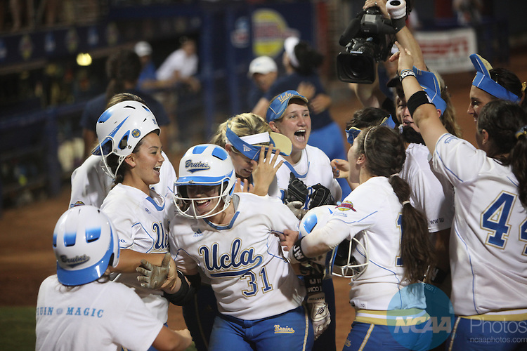 07 JUNE 2010:  UCLA takes on the University of Arizona during the Division I Women's Softball Championship held at ASA Hall of Fame Stadium in Oklahoma City, OK.  Stephen Pingry/NCAA Photos