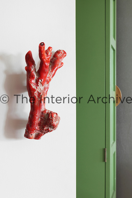 Detail of a coral handle on the door to the office