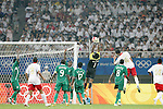 19 August 2008: Ambruse Vanzekin (NGA) (1) leaps to catch a Belgium corner kick.  The men's Olympic soccer team of Nigeria defeated the men's Olympic soccer team of Belgium 4-1 at Shanghai Stadium in Shanghai, China in a Semifinal match in the Men's Olympic Football competition.
