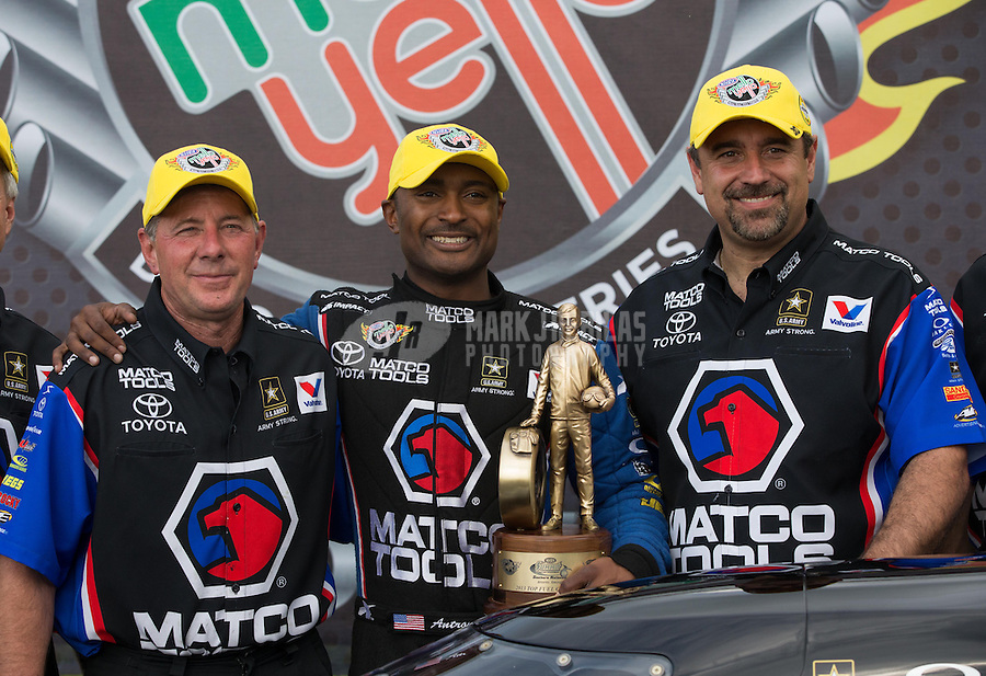 May 11, 2013; Commerce, GA, USA: NHRA top fuel dragster driver Antron Brown (center) celebrates with crew chief Mark Oswald (left) and Brian Corradi after winning the Southern Nationals at Atlanta Dragway. Mandatory Credit: Mark J. Rebilas-