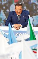 Il leader del Popolo della Liberta' Silvio Berlusconi sul palco durante la manifestazione contro tasse, burocrazia e sistema giudiziario, in piazza del Popolo a Roma, 23 marzo 2013..Italian center-right People of Freedom (PdL) party's leader Silvio Berlusconi attends a demonstration against austerity measures, burocracy and judicial system, in Rome, 23 March 2013..UPDATE IMAGES PRESS/Isabella Bonotto
