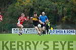Dr Crokes exciting young forward Tony Brosnan shoots another point under pressure from Cian O'Mhurchú during  their SFCC clash in Lewis Road on Saturday