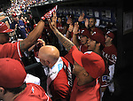 Rangers team group,<br /> JUNE 6, 2014 - MLB :<br /> Michael Choice (L) of the Texas Rangers is congratulated by teammates including Yu Darvish in the dugout after hitting a solo home run in the bottom of the seventh inning during the Major League Baseball game against the Cleveland Indians at Globe Life Park in Arlington in Arlington, Texas, United States. (Photo by AFLO)