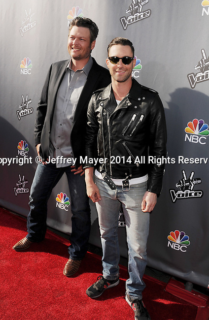 HOLLYWOOD, CA- APRIL 03: Musicians Blake Shelton (L) and Adam Levine arrive at NBC's 'The Voice' red carpet event at The Sayers Club on April 3, 2014 in Hollywood, California.