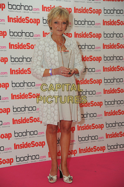 Gillian Wright.The Inside Soap Awards 2012, One Marylebone,  London, England..September 24th, 2012 .full length white dress lace jacket trophy winner .CAP/CAS.©Bob Cass/Capital Pictures.