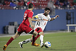 12 December 2008: Rich Costanzo (6) of Maryland cuts the ball away from Ale Ivo (22) of St. John's.  The University of Maryland Terrapins defeated the St. John's University Red Storm 1-0 during the second sudden death overtime at Pizza Hut Park in Frisco, TX in an NCAA Division I Men's College Cup semifinal game.