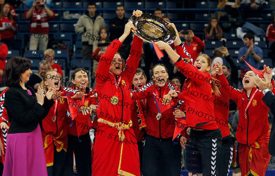 BELGRADE, SERBIA - DECEMBER 16: Montenegro handball team celebrate gold medal during the Women's European Handball Championship 2012 medal ceremony at Arena Hall on December 16, 2012 in Belgrade, Serbia. (Photo by Srdjan Stevanovic/Getty Images)