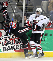 UNO's Michael Young sends St. Cloud State's Cory Thorson to the ice. UNO beat St. Cloud State 3-0 Friday night at Qwest Center Omaha.  (Photo by Michelle Bishop)
