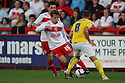 Luke Freeman of Stevenage takes on Sammy Moore of Wimbledon. Stevenage v AFC Wimbledon - Capital One Cup First Round - Lamex Stadium, Stevenage . - 14th August, 2012. © Kevin Coleman 2012