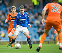 RANGERS' STEVEN DAVIS TRIES TO GET THROUGH THE UNITED DEFENCE