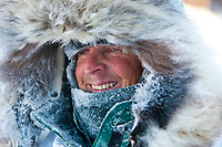 Lachlan Clarke is frosted up after arriving at the Ruby checkpoint during the 2010 Iditarod