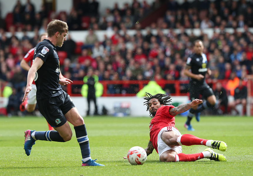 Nottingham Forest's Armand Traore is shown a yellow card for this challenge <br /> <br /> Photographer Rachel Holborn/CameraSport<br /> <br /> The EFL Sky Bet Championship - Nottingham Forest v Blackburn Rovers - Friday 14th April 2016 - The City Ground - Nottingham<br /> <br /> World Copyright &copy; 2017 CameraSport. All rights reserved. 43 Linden Ave. Countesthorpe. Leicester. England. LE8 5PG - Tel: +44 (0) 116 277 4147 - admin@camerasport.com - www.camerasport.com