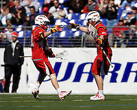 Drew Snider (32) and John Haus (26) of Maryland celebrate a goal during the Face-Off Classic in at M&T Stadium in Baltimore, MD